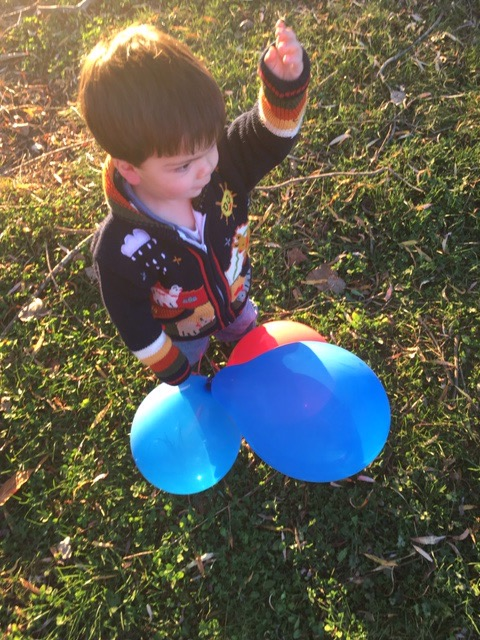 Joey aged two with his balloons having fun