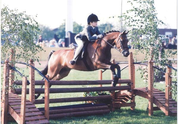 Daisy aged 12 jumping Tyn-y-Cafe Merlin in the Working Hunter pony class at BSPS Summer Championships