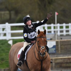 Daisy Smith riding arena evening with confidence