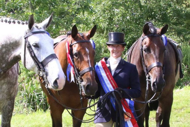 Jayne Ross surrounded by champion horses